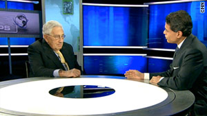 Former U.S. Secretary of State Henry Kissinger, left, talks to CNN's Fareed Zakaria on Sunday.