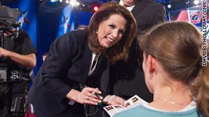 Rep. Michele Bachmann signs an autograph Monday at a GOP presidential debate in New Hampshire.