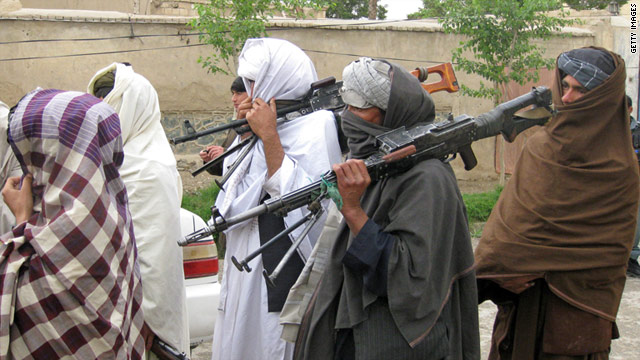 Taliban fighters peacefully surrender arms during a meeting with Afghan government officials on  April 11 in Kandahar.