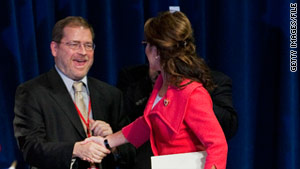 Grover Norquist, shown greeting former Alaska Gov. Sarah Palin last year, leads the group behind the no-tax-hike pledge.