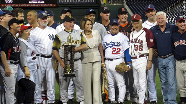 Congressional Democrats celebrate winning the 50th annual Congressional Baseball Game on Thursday.