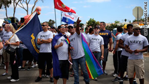 Service members prepare to march in the San Diego gay pride parade on July 16.