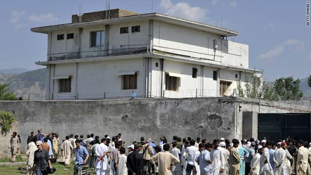 Local residents gather outside the hideout of Al-Qaeda leader Osama bin Laden following his death by U.S. Special Forces.