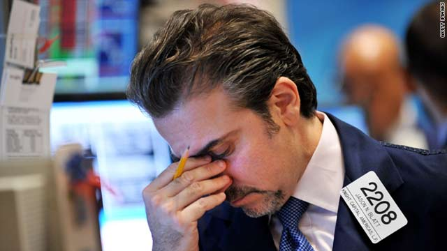 Jason Blatt of Knight Capital Americas LP reacts to the down market at the New York Stock Exchange on Monday, August 8.