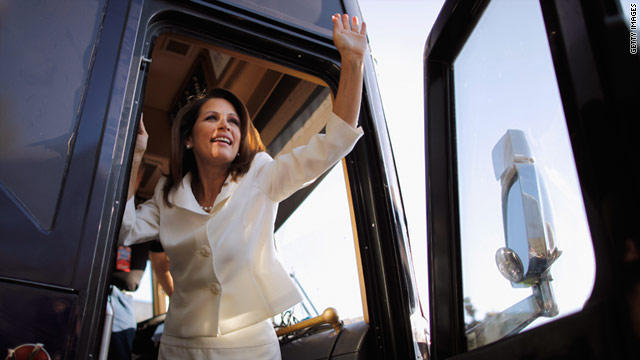 Rep. Michele Bachmann waves to supporters Saturday at Iowa State University after winning the straw poll in Ames.