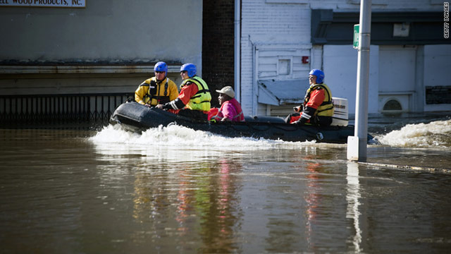Rescuers save a stranded man in Paterson, New Jersey, on Tuesday, after Hurricane Irene caused flooding.