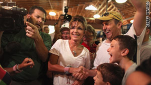 Former Alaska Gov. Sarah Palin meets with fairgoers in the Cattle Barn at the Iowa State Fair.