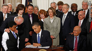 President Obama signs the Affordable Health Care for America Act at the White House on March 23, 2010.