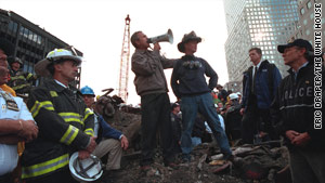 President Bush and retired firefighter Bob Beckwith stand on the rubble of the World Trade Center.