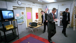 President Bush reacts to live video of the burning World Trade Center at a classroom at Emma Booker Elementary School in Sarasota.