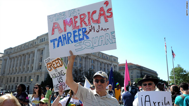 "Anti-corporate protesters display banners as they take part in a ""Occupy D.C."" protest in Washington on Thursday."