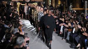 Models walk the runway during Paris Fashion Week 2011.