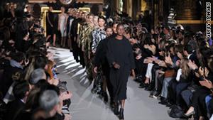 Models walk the runway during Paris Fashion Week 2011.