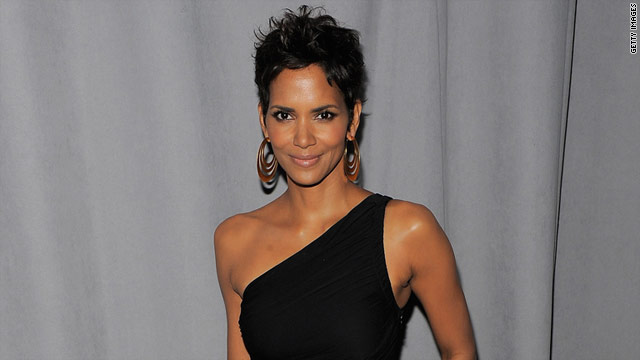 Off-duty officers hired by Halle Berry called police Monday and said they were holding a burglary suspect at her home.