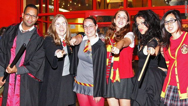 "Fans in New York dress up in Harry Potter style to attend the opening of ""Harry Potter and the Deathly Hallows Part II."""