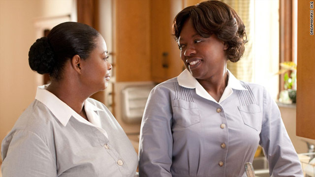 "Octavia Spencer, left, stars as Minny Jackson and Viola Davis as Aibileen Clark in ""The Help."""