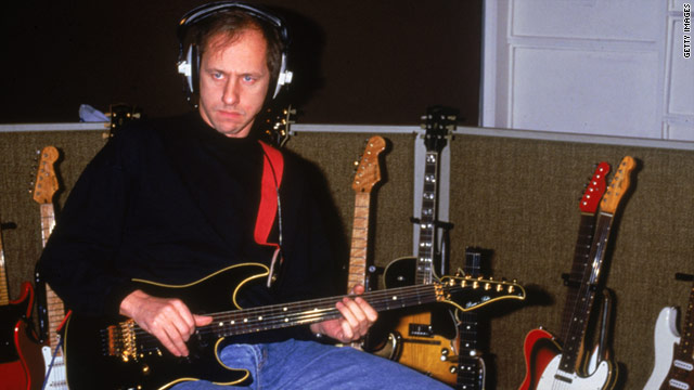 Mark Knopfler, lead singer of Dire Straits, tries out one of a large collection of guitars in 1987.