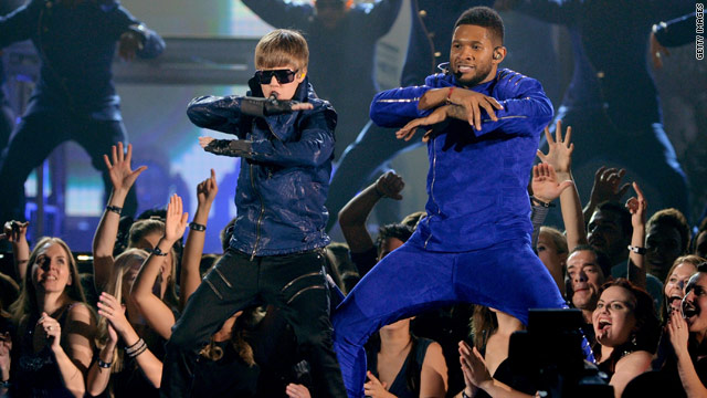 Justin Bieber, left, and Usher peform at the 53rd annual Grammy Awards.