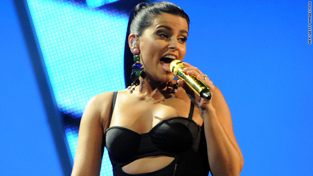 Singer Nelly Furtado, pictured in November, admits she performed for Moammar Gadhafi's family in 2007 for $1 million.