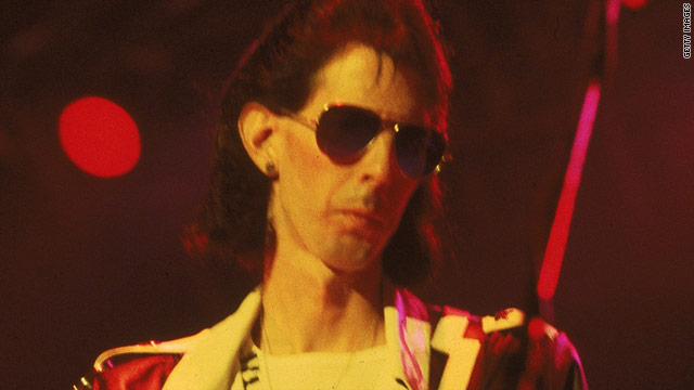 Ric Ocasek plays on stage sometime during the 1980s.