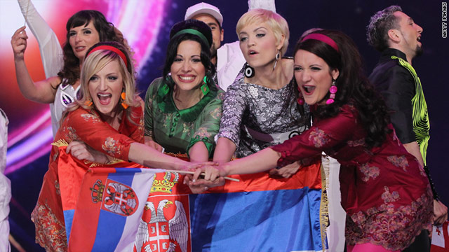 Nina of Serbia, second from right, celebrates after advancing to the next round at Eurovision.