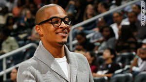 Rapper T.I. looks on during a game between the Miami Heat and the Atlanta Hawks at Philips Arena in October 2010.