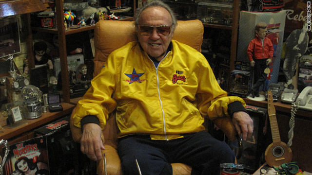 George Barris, designer of some of television's most famous cars, sits among his memorabilia.