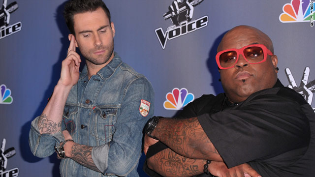 """The Voice"" judges Adam Levine and Cee Lo Green goof off at a press conference."