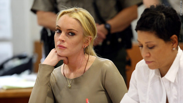 Lindsay Lohan attends a hearing Thursday with her attorney, Shawn Chapman Holley, in a Los Angeles courtroom.