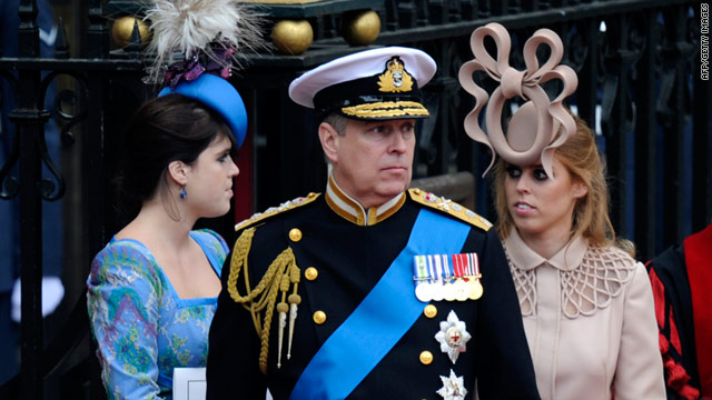 Princess Beatrice, right, and her hat steal the show as she and Prince Andrew and Princesse Eugenie exit Westminster Abbey.