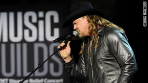 Trace Adkins was on a plane to Alaska for two shows and some fishing when the fire happened.