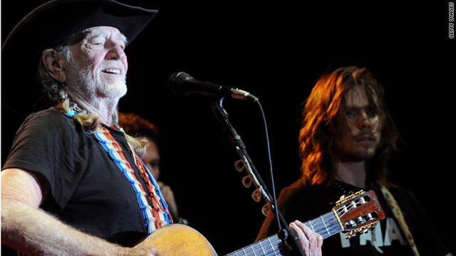 Willie Nelson, fined $500 for drug paraphernalia possession, sings with his son, Lukas, in Nashville earlier this month.