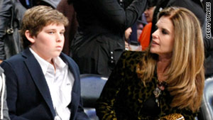 Christopher Schwarzenegger attends a basketball game earlier this year with his mother, Maria Shriver.