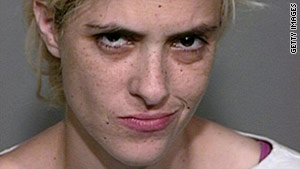 Samantha Ronson poses for a mug shot after being arrested for drunk driving near Baker, California.