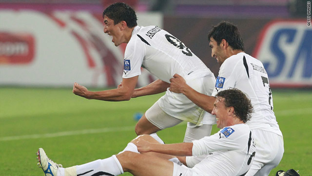 The Uzbek players celebrate scoring their second goal in the 2-0 Asian Cup win over hosts Qatar.