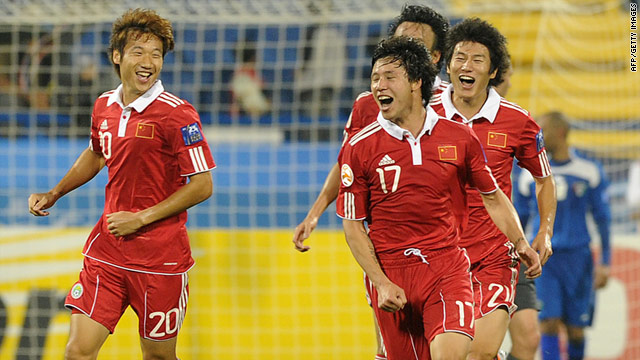 China defender Zhang Linpeng, number 17, celebrates after scoring his team's opening goal against Kuwait on Saturday.