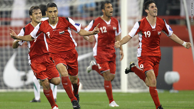 Syria midfielder Abulrazaq al-Husein, left, celebrates after scoring the winning goal against Saudi Arabia.