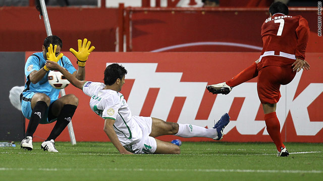 Gholam Reza Rezaei fires Iran's equalizing goal past Iraq goalkeeper Mohammed Kassid on Tuesday night.