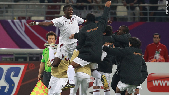 A delighted Yusuf Ahmed, No. 12, was mobbed by his teammates after scoring against China on Wednesday.