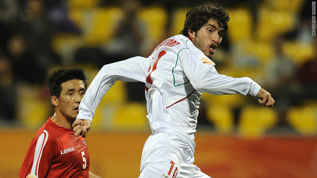 Karim Ansari Fard scores Iran's winning goal against North Korea at the Qatar Sports Club on Saturday.