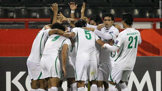 Iraq players celebrate the goal that secured their place in the last eight of the Asian Cup.