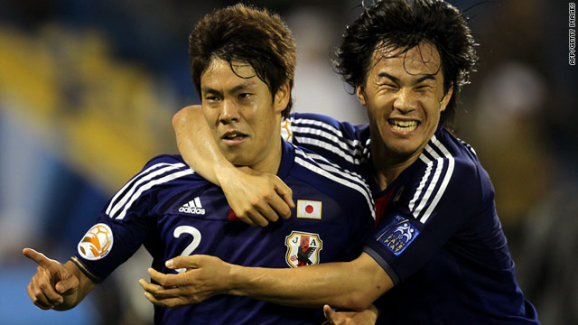 Japan's match-winner Masahiko Inoha, left, celebrates with teammate Shinji Okazaki at Doha's at Al-Gharafa Stadium.
