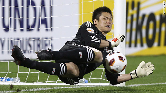 Goalkeeper Eiji Kawashima was Japan's hero, saving two South Korea penalties in the shoot out.