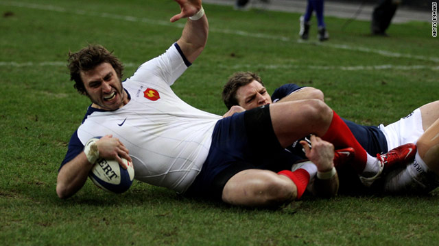 France winger Maxime Medard crosses for his team's opening try against Scotland in Paris on Saturday.