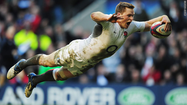 England's Chris Ashton ran in four of his team's eight tries as Martin Johnson's men overcame Italy 59-13 at Twickenham.