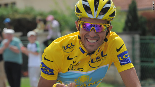 Contador celebrates his third win in the Tour de France but he failed a drugs test just four days before.
