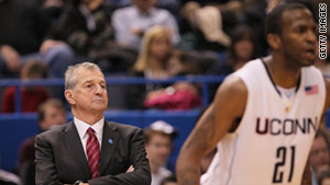UConn coach Jim Calhoun allowed a booster and NBA agent to participate in recruitment, the NCAA says.