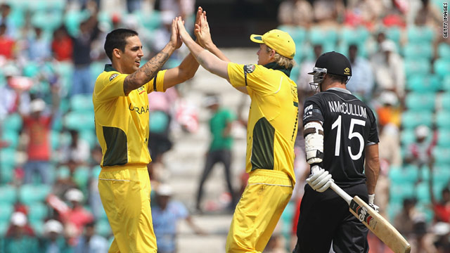 Mitchell Johnson, left, celebrates with Cameron White after dismissing New Zealand batsman Nathan McCullum.