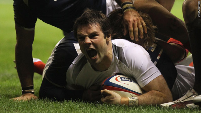 Ben Foden celebrates after scoring his third international try in England's victory over France on Saturday.