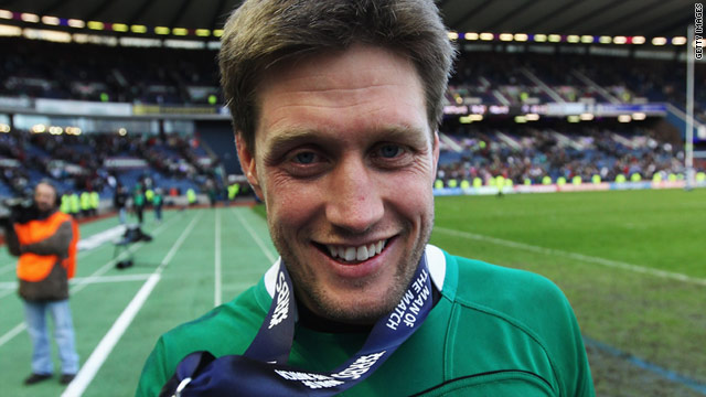Irish flyhalf Ronan O'Gara displays his man of the match medal after Ireland won at Murrayfield.